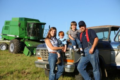 Farmer with family by pickup truck
