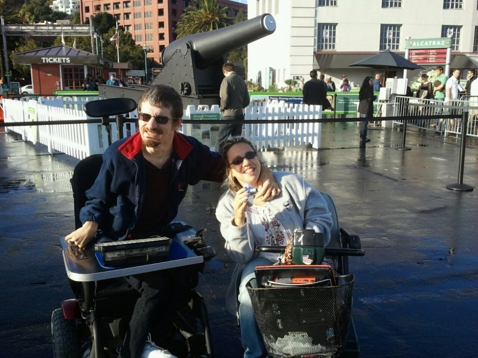 Photo of Jon and Sarah Feucht, both in wheelchairs, in San Francisco