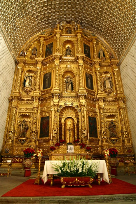 Ornate altar painted in gold plate from floor to ceiling