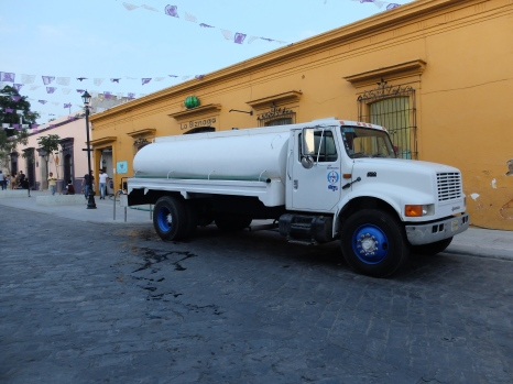A Water Truck Pumping Water to a Restaurant