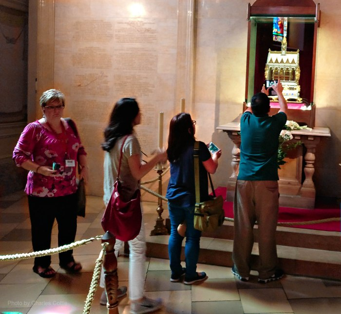 Tourists line up to view and take photos of the right hand of St. Stephen
